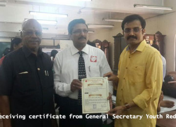 DLS receiving certificate from General Secretary of Youth Red Cross